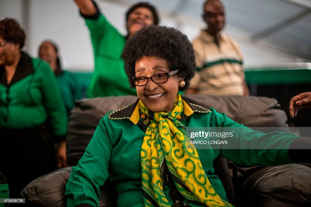 Africa National Congress stalwart Winnie Madikizela Mandela looks on as she is greeted by Women League supporters gathered in Soweto on September 26, 2016 to celebrate her 80th birthday.