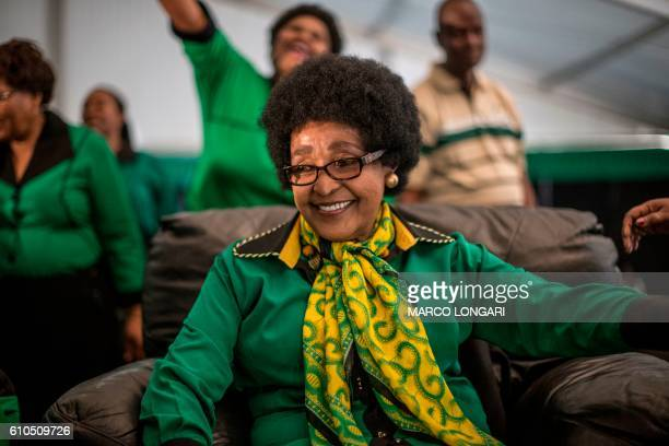 Africa National Congress stalwart Winnie Madikizela Mandela looks on as she is greeted by Women League supporters gathered in Soweto on September 26...