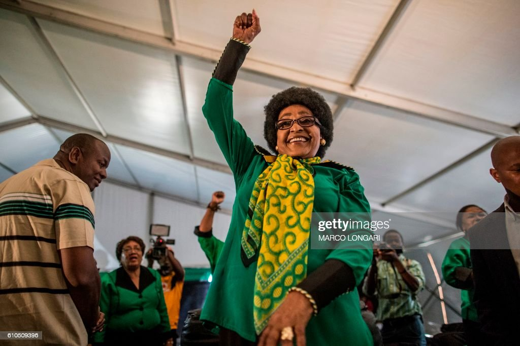 Africa National Congress stalwart Winnie Madikizela Mandela raises her fist in her signature move as she acknowledges a crowd of ANC Women League supporters gathered in Soweto on September 26, 2016 to celebrate her 80th birthday.
