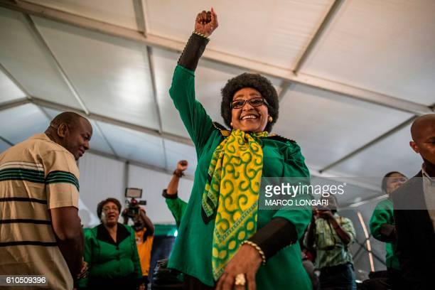 Africa National Congress stalwart Winnie Madikizela Mandela raises her fist in her signature move as she acknowledges a crowd of ANC Women League...