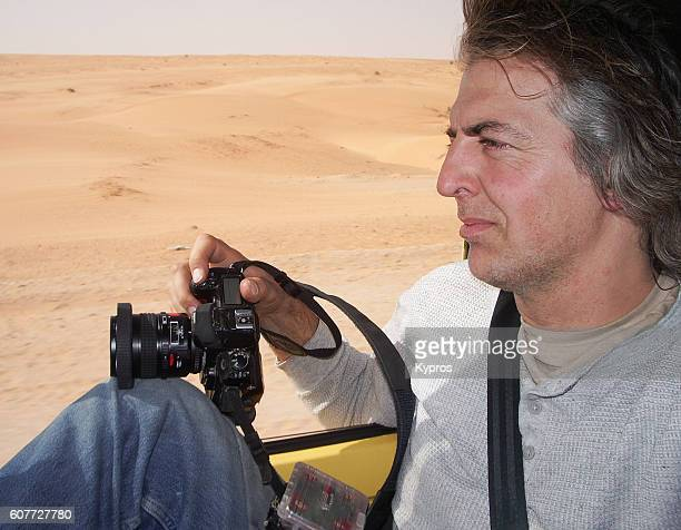 africa, north africa, mauritania view of photographer with camera in sahara desert (year 2007) - photojournalist stock pictures, royalty-free photos & images
