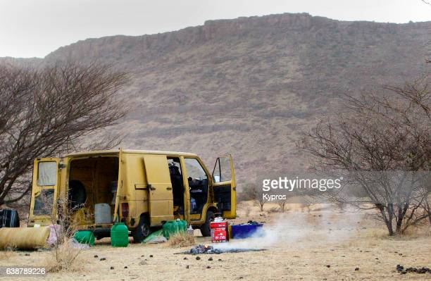 Africa, North Africa, Mauritania, View Of Sahara Desert Campsite Dusk With French Postal Van And Camp Fire (Year 2007)