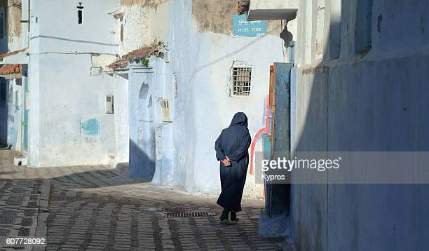 Africa, North Africa, Morocco, View Of Elderly Man Walking Through Village At Dawn Wearing Djellaba, A Long, Loose-Fitting, Unisex, Outer Robe Or Coat (Year 2007)