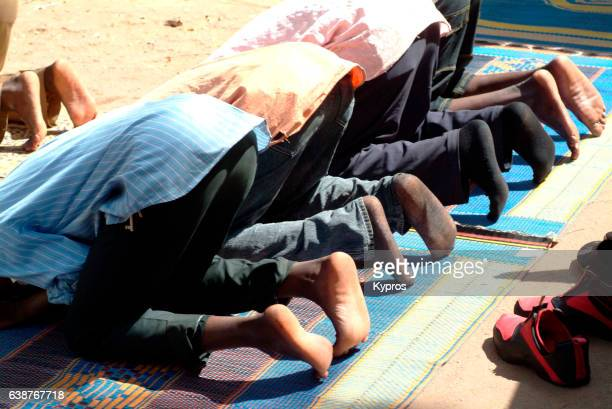 africa, north africa, niger, niamey, view of muslim men praying (year 2007) - foot worship stock pictures, royalty-free photos & images