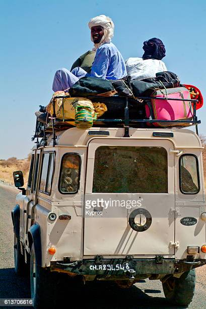Africa, North Africa, Niger, View Of Africa, North Africa, Niger, View Of Overloaded Taxi Or Bus With Passengers Sitting On Roof (2007)