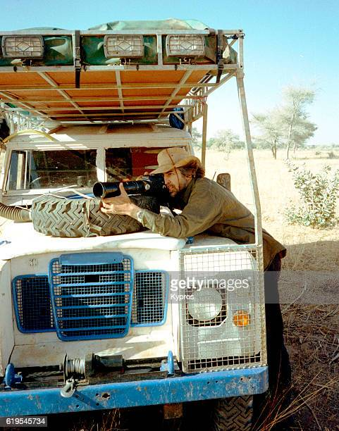 Africa, North Africa, Niger, View Of Professional Photographer And Explorer Taking Pictures In Sahara Desert (Year 2000)
