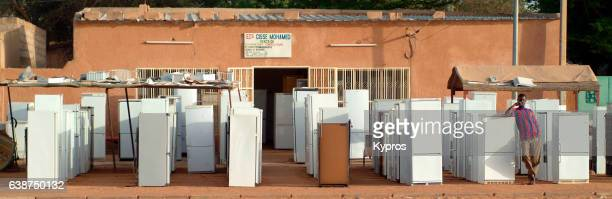 africa, north africa, niger, view of refrigerator shop. electricity coming soon, and with it, bills that need to be paid with money. how to to that? (year 2007) - coming soon stock pictures, royalty-free photos & images