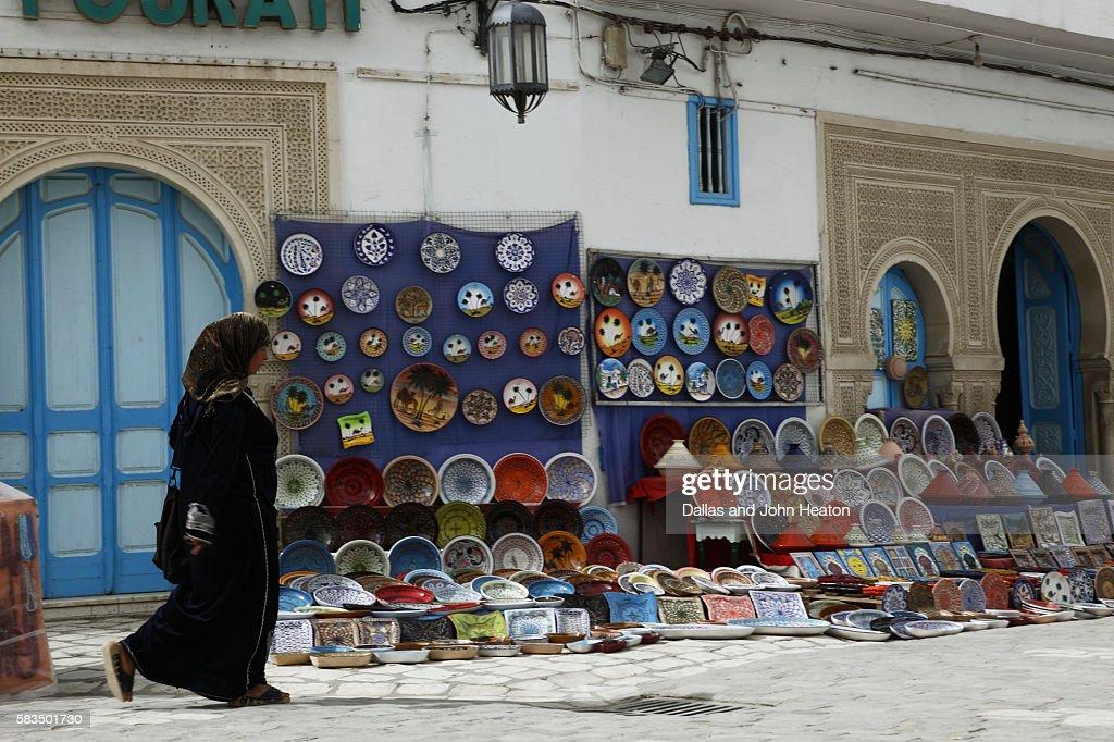 Africa, North Africa, Tunisia, Kairouan, Medina Street Scene, Handicraft Stalls, Woman : Stock Photo