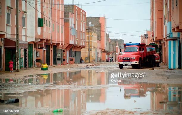 Africa, North Africa, Western Sahara Or Spanish Sahara, Occupied By Morocco, View Of Residential Street On Rainy Day With Red Truck (2007)