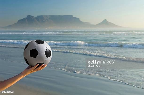 Africa, South Africa, Kapstadt, Person holding soccer ball, close-up