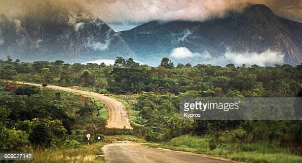 africa, southern africa, mozambique, landscape view of forest and mountains and road (year 2000) - mozambique stock pictures, royalty-free photos & images