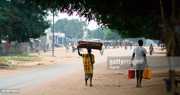 africa, southern africa, mozambique, mueda, view of muslim man carrying stack of firewood on his head - モザンビーク ストックフォトと画像