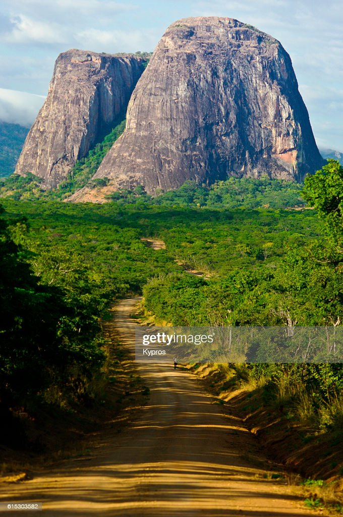 Africa, Southern Africa, Mozambique, View Of Beautiful Landscape With Unusual Hills And Dirt Track. While Taking This Photo, Teenage Passenger In Car Had Severe Fractured Leg And Was Bleeding Everywhere. The Gearbox Was Broken, And We Had A Four Hour Driv : Stock-Foto