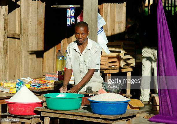 Africa, Southern Africa, Mozambique, View Of Man Selling Rice From Market Stall (Year 2009)