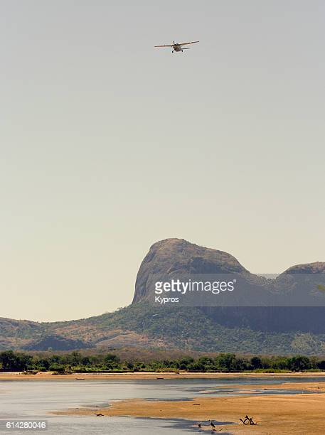 Africa, Southern Africa, Mozambique, View Of Private Aircraft Landing In Jungle