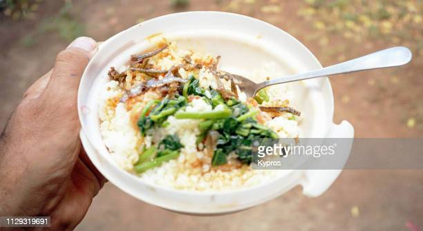 africa, tanzania, 2000: view of ($0.25 usd) plate of food. - 干物 ストックフォトと画像
