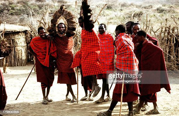 Africa Tanzania Maasai Compound and Male costumed Jumpers in the Serengeti