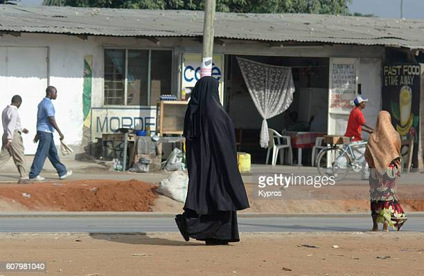 Africa, Tanzania, View Of Muslim Woman Wearing Hajib Walking Through Town (Year 2009)