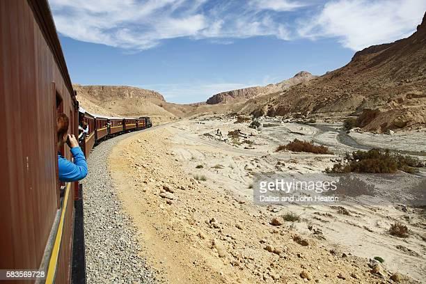 Africa, Tunisia, Metlaoui, Red Lizard ( Lezard Rouge ) Train, Sightseer at Window