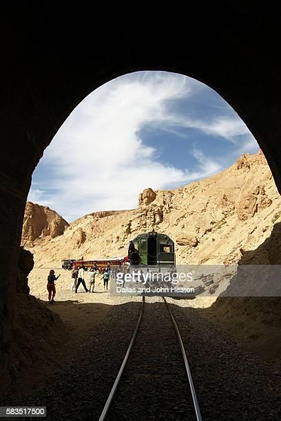 Africa, Tunisia, Metlaoui, Selja Gorge, Red Lizard ( Lezard Rouge ) Train viewed through Tunnel, Sightseers