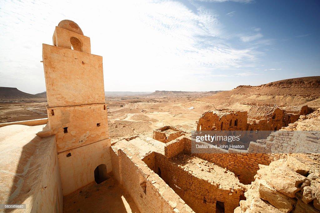 Africa, Tunisia, Tataouine, Ruins of Berber Village of Douiret overlooking Jebel Dahar Mountains : Stock Photo