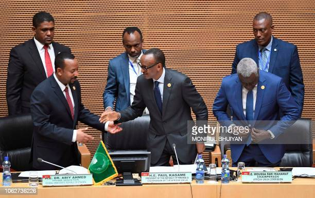 Africa Union Chairperson and the President of Rwanda Paul Kagame stands next to Ethiopia's Prime Minister Abiy Ahmed and the Chairperson of the...