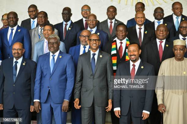 Africa Union Commission Chairperson Moussa Faki Mahamat poses for a family photo on November 17 2018 with Africa's Presidents Sudan's Omar alBashir...