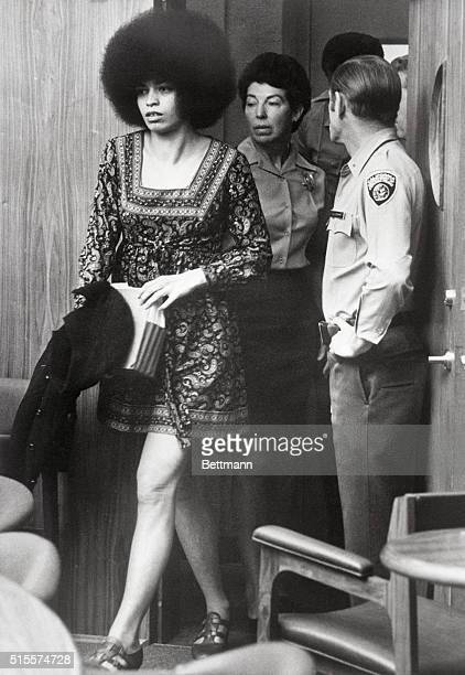 African American activist and Communist intellectual Angela Davis enters a San Rafael courtroom for a pre-trial hearing. She was later tried and...