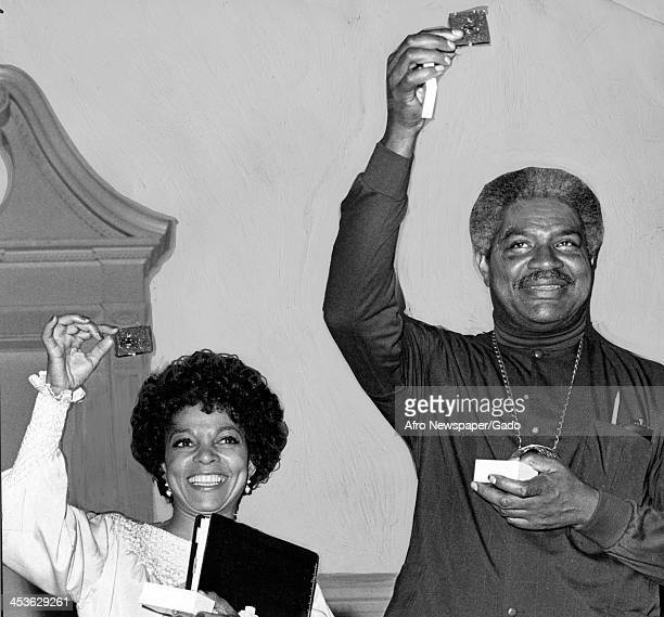 African American actor Ossie Davis and wife Ruby Dee display awards following a staged reading Greensboro North Carolina May 7 1973