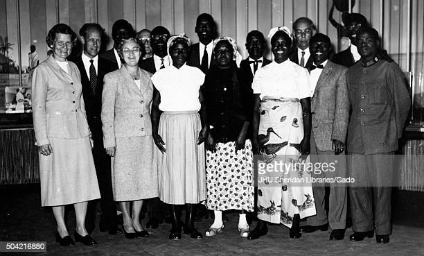 African American and Caucasian churchgoers standing and posing for a group photograph Plainview Texas 1958
