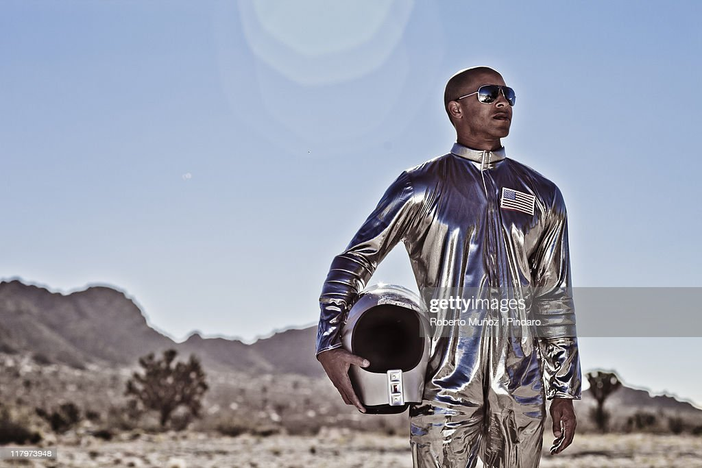 African american astronaut stands : Stock Photo