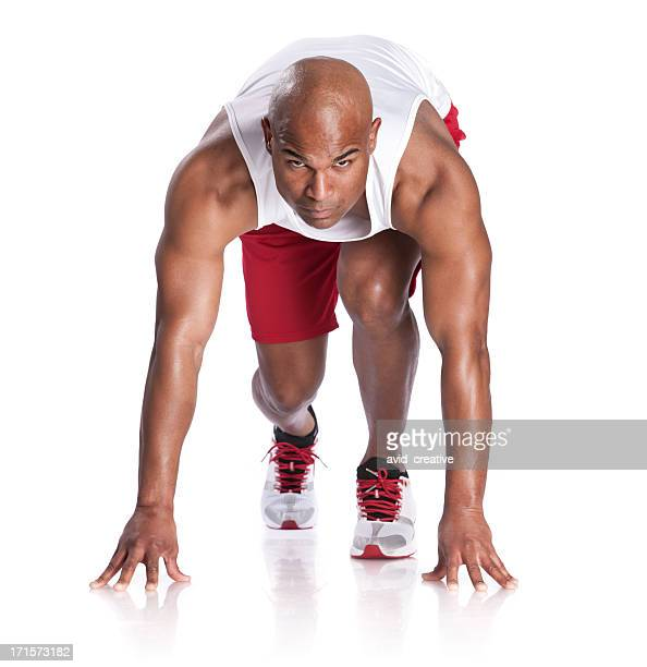 african american athlete in  runner's starting stance - one mid adult man only stock pictures, royalty-free photos & images