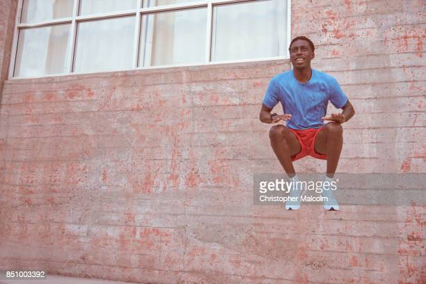 African American athlete jumping in the air while excercising