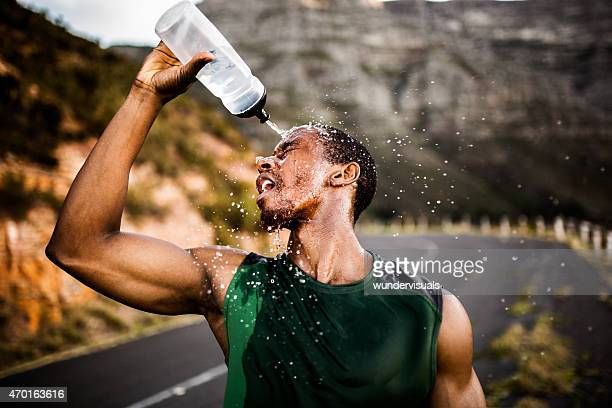 african american athlete splashing water on his face after excer - sportsperson stock pictures, royalty-free photos & images