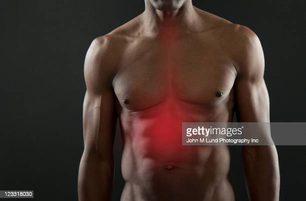 African American athlete with glowing stomach