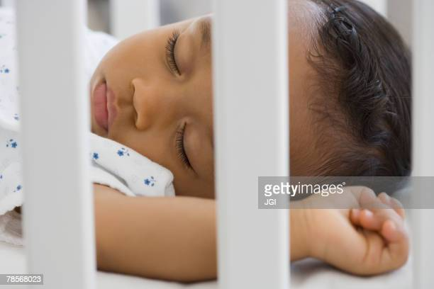 African American baby sleeping in crib