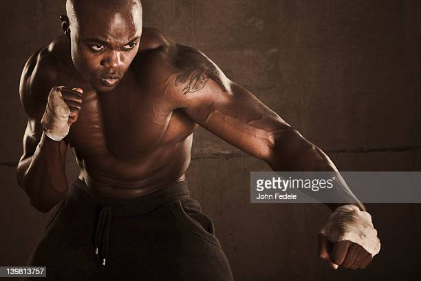 African American boxer preparing to punch