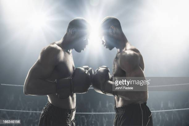 African American boxers standing in boxing ring