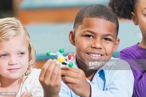 African American boy and friends in science class