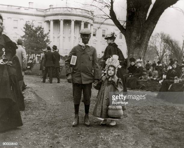 African American Boy and Young White Girl at the Easter Egg Roll at the White House