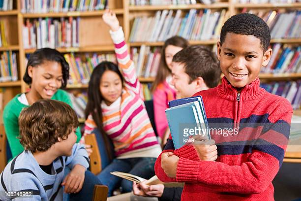 African American boy in school library smiling