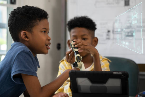 African american boy is assembling toy robot in automated class.