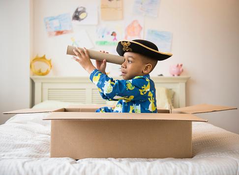 African American boy playing in cardboard box - gettyimageskorea