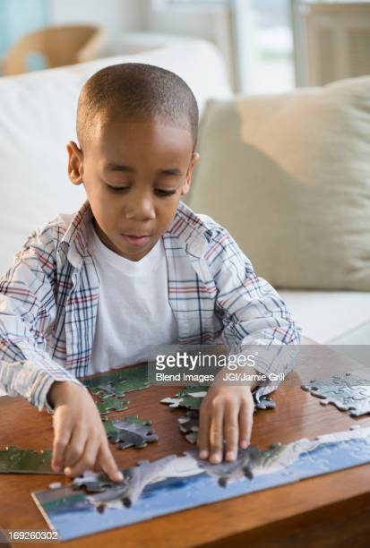 African American boy playing with jigsaw puzzle