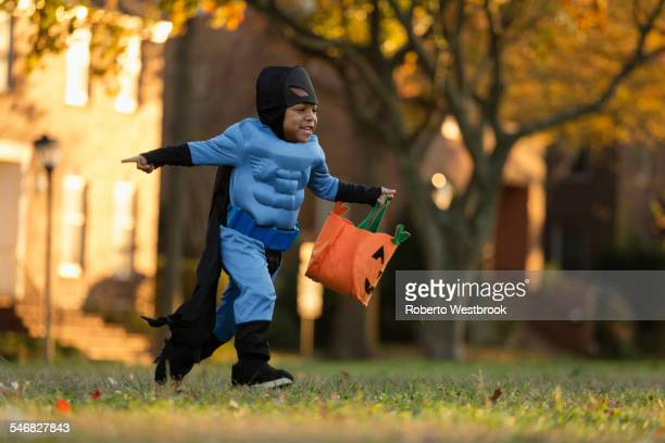 african american boy trick-or-treating on halloween - trick or treat stock pictures, royalty-free photos & images