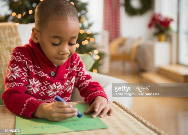 African American boy writing letter to Santa