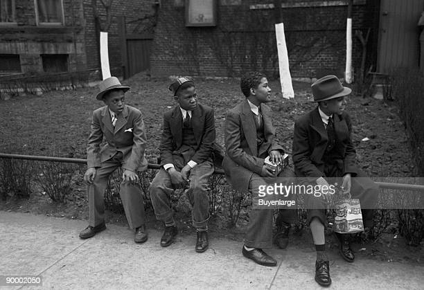 African American Boys waiting outside of Episcopal Church to see the processional South Side of Chicago Illinois
