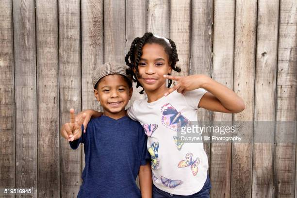 african american brother and sister hugging near wooden fence - sister stock pictures, royalty-free photos & images
