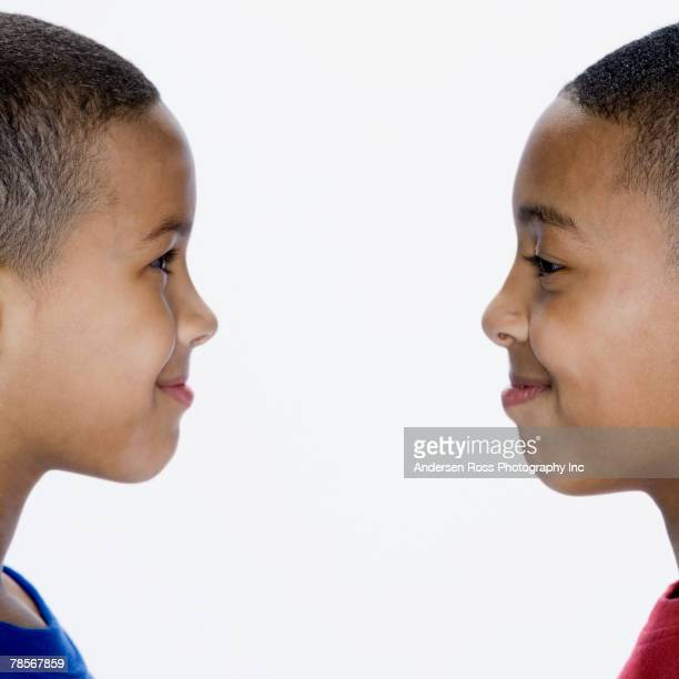 African American brothers smiling at each other