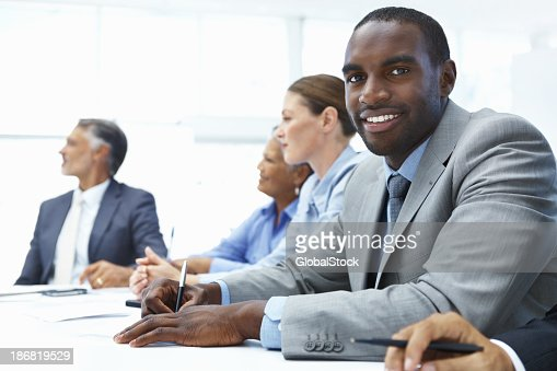 African American Business Man Sitting In A Meeting Stock